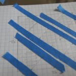 Tape off one direction to outline outer squares and center square