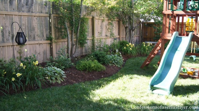 Back yard makeover one year later confessions of a serial do it yourselfer - Landscaping along a fence ...