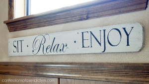 Sign made from an old fence picket from COnfessionsofaserialdiyer.com
