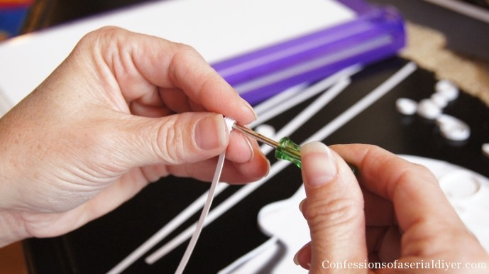 Use a tiny flathead screwdriver to roll paper for quilling