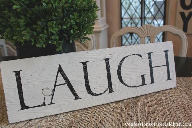 """Laugh"" sign from old fence picket"