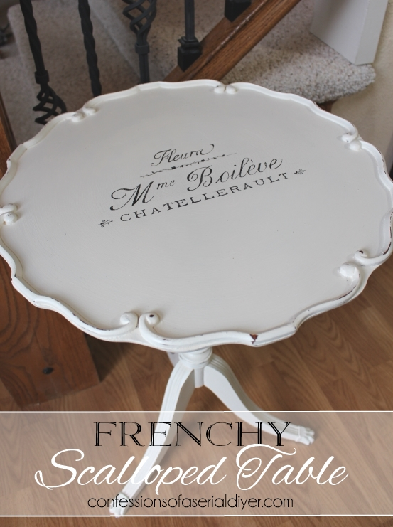 Antique scalloped table with french graphics