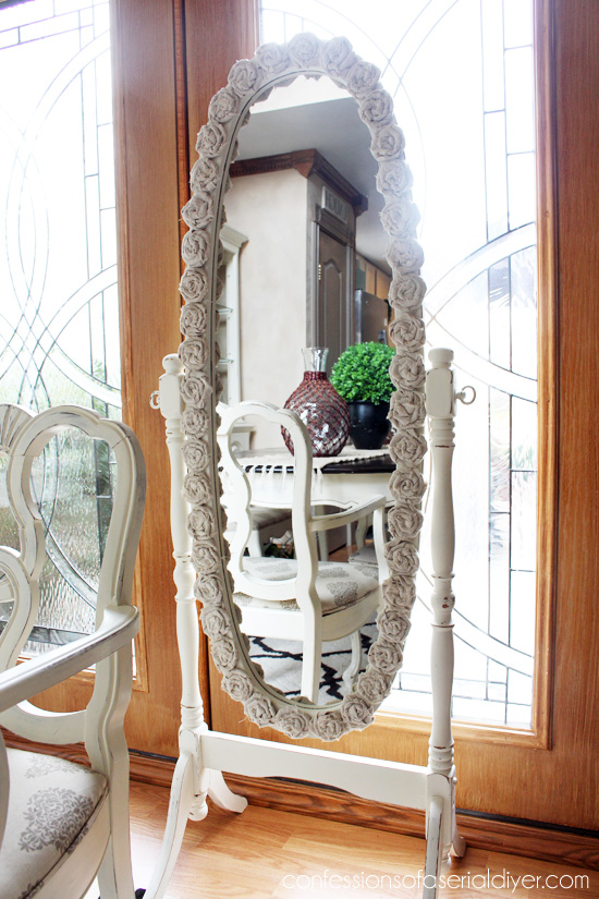 Rosette-Framed MIrror {Drop cloth is perfect for shabby rosettes!)