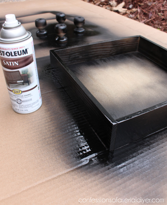 Spray-painting in a dark brown first allows a stained wood look to come through after sanding the top color rather than new wood!