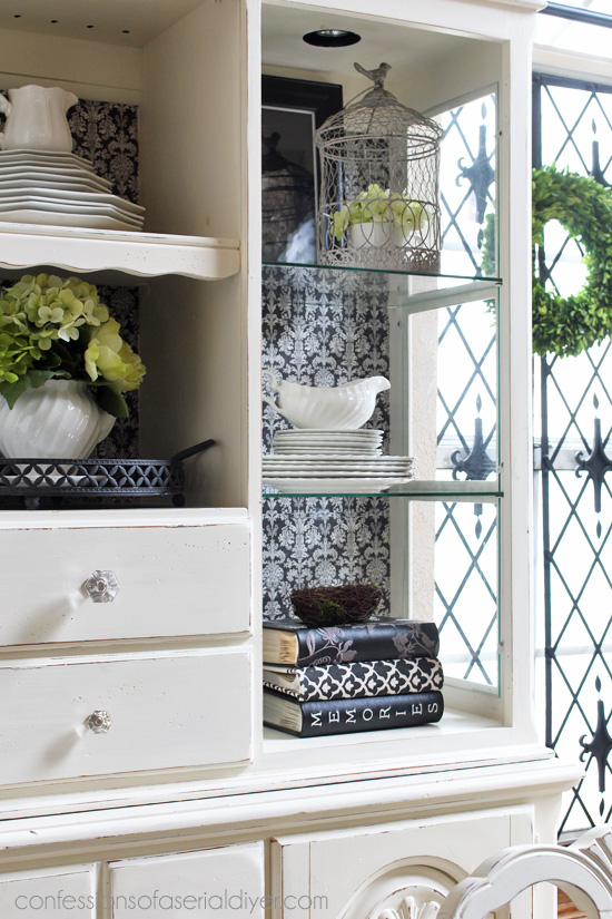 Give a hutch a whole new look for less than $5 with scrapbook paper!