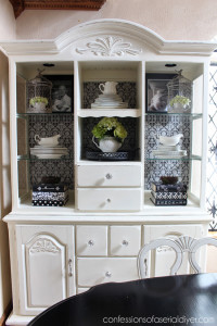 Adding scrapbook paper to the back of this hutch gave it a whole new look, for less than $5!