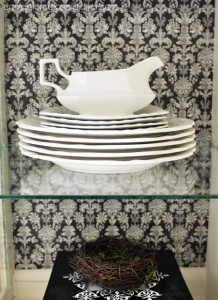 The ironstone really pops against the black damask print.