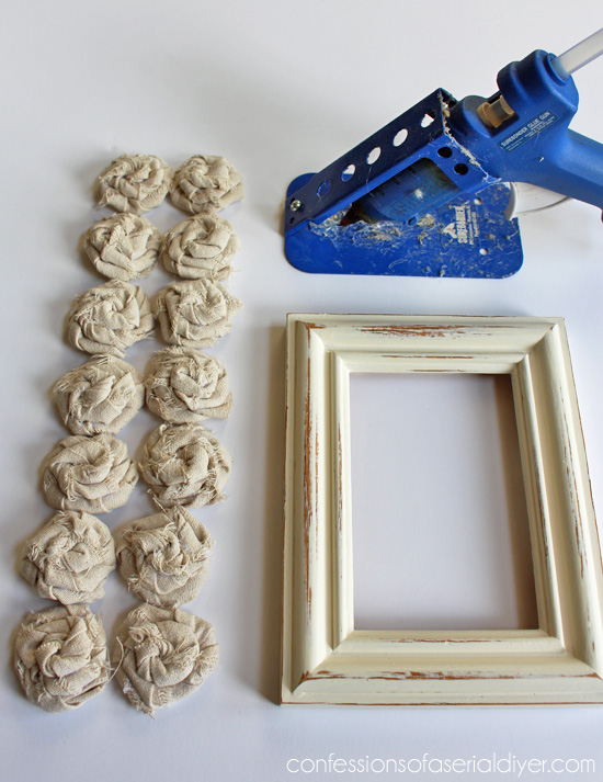 Rosettes made form drop cloth make this frame adorable!