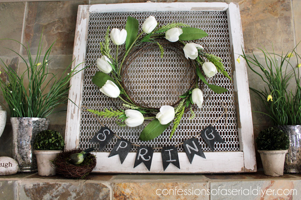 One more use for an old window...as the perfect backdrop for a wreath, by adding a metal grate.