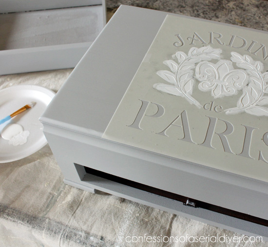 Fleur-de-lis stencil gives this little chest a sophisticated feel.