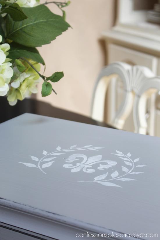 Fleur-de-lis stencil gives this little chest a sophisticated feel.