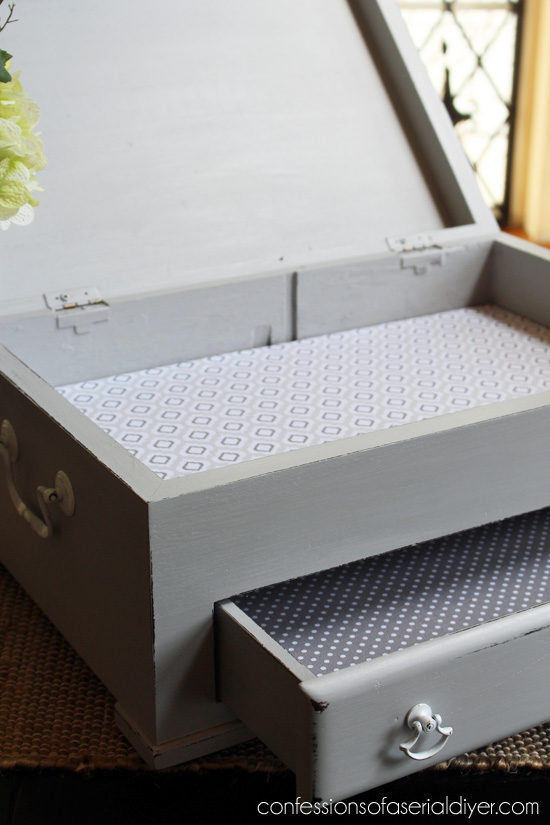 Flatware box made gorgeous with a little paint and fabric. Now it can hold more than just flatware!