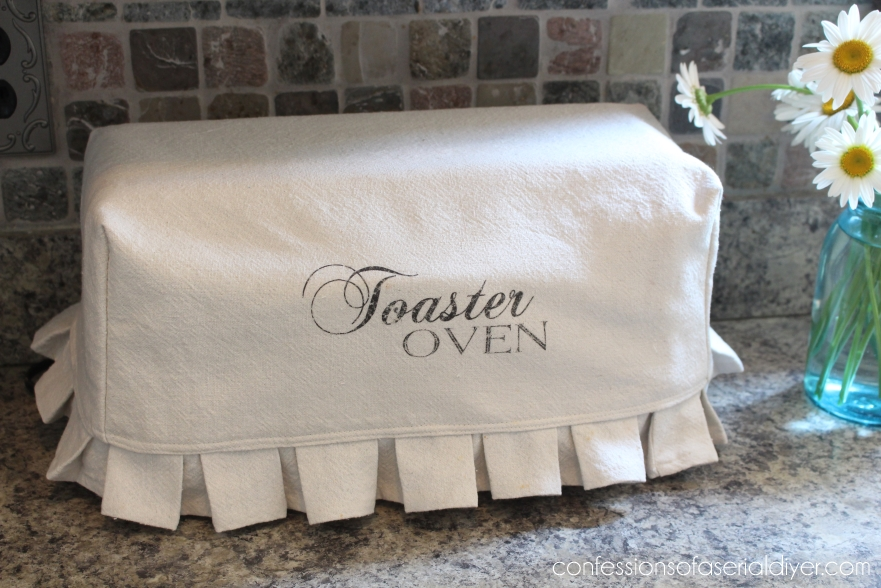Sweet toaster oven cover in white with the word toaster oven on it.