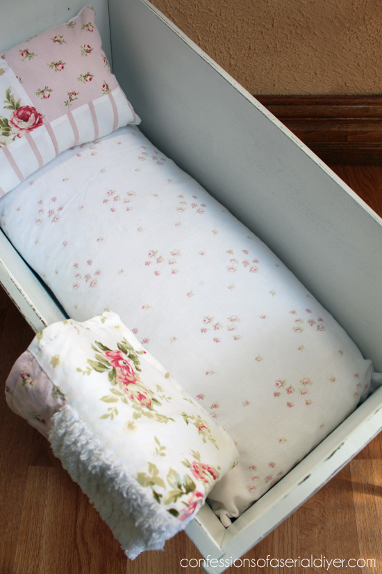 An old feather pillow form, cut in half, makes a great doll bed mattress!
