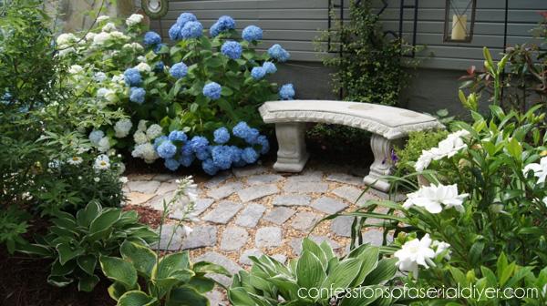 Side yard with circular stone patio