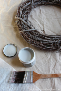 Dry brushing the grapevine wreath with soft gray paint first will give it a washed look, perfect for a Summer shell wreath