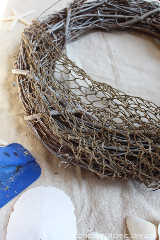 Fish net makes the perfect base for this shell wreath.
