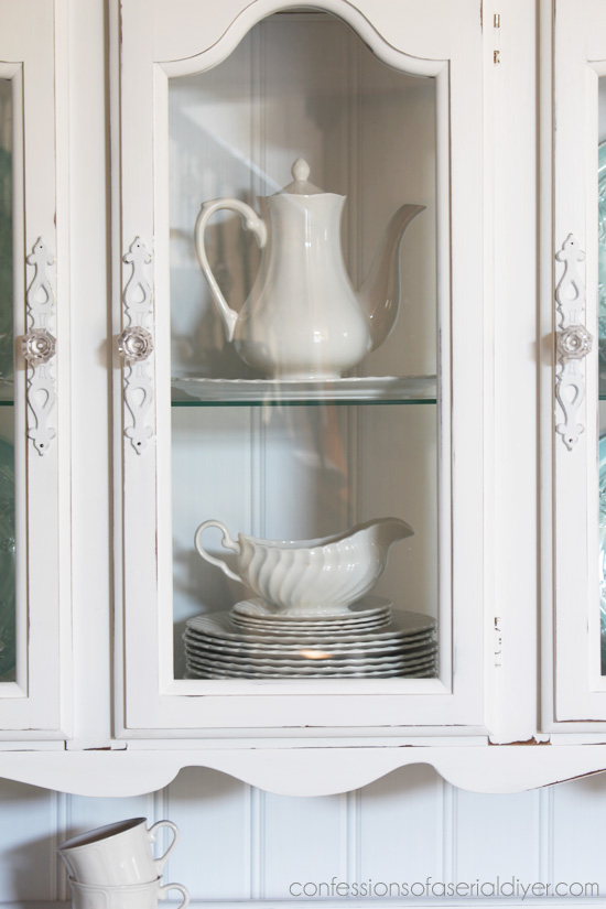 Adding bead board to the back of a hutch adds instant cottage charm