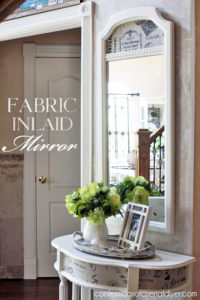 Vintage Mirror updated by adding fabric to the panel! confessionsofaserialdiyer.com