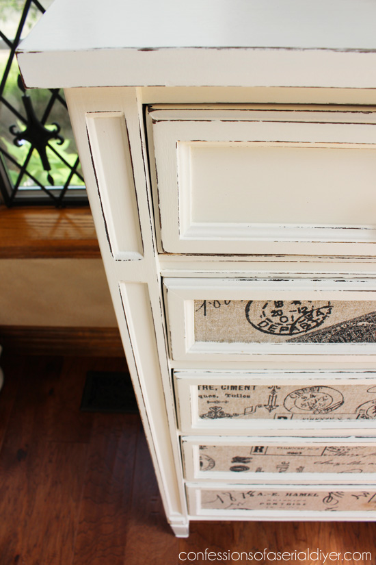 Use matte Mod Podge to attach fabric to drawer fronts for a whole new look.