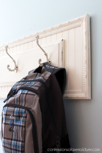 Pair an old drawer front and a thrift store frame to create a simple hanging rack!
