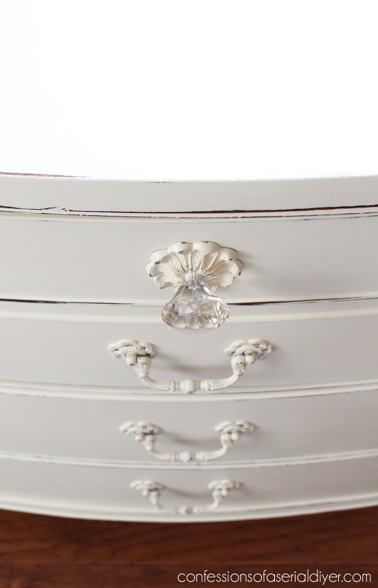 Pretty glas knobs are perfect for this shabby chic dresser