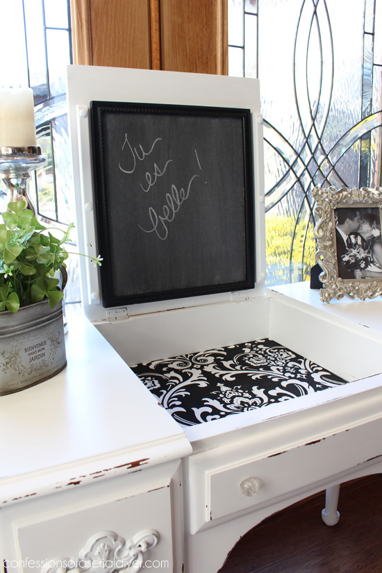 Fabric is perfect for lining drawers and spaces like this. I adhered it with matte Mod Podge.