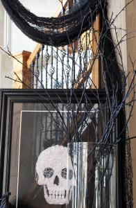 Spray paint branches black for instant height for cheap!