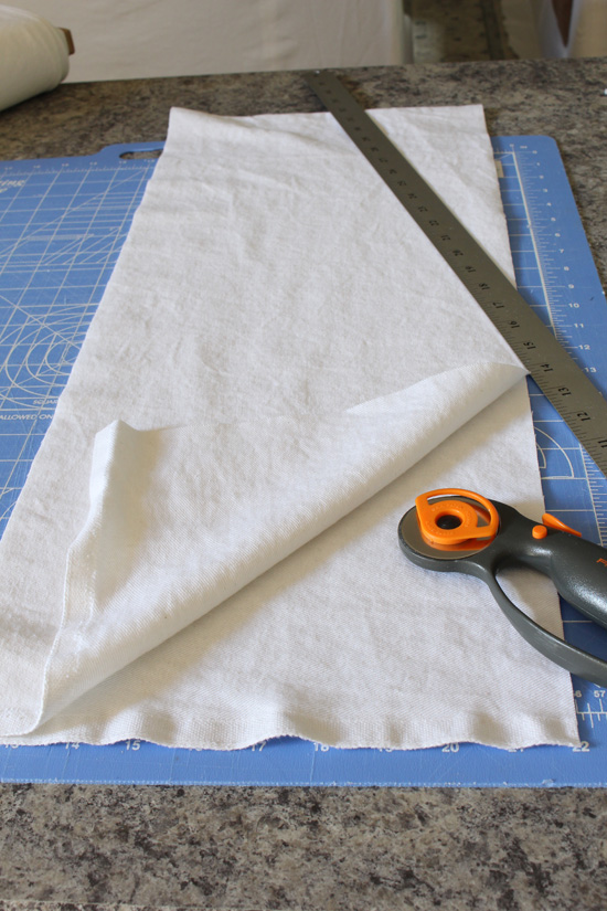 A rotary cutter and a straight edge make cutting so much easier and more precise. How to make custom cushion covers with Confessions of a Serial Do-it-Yourselfer
