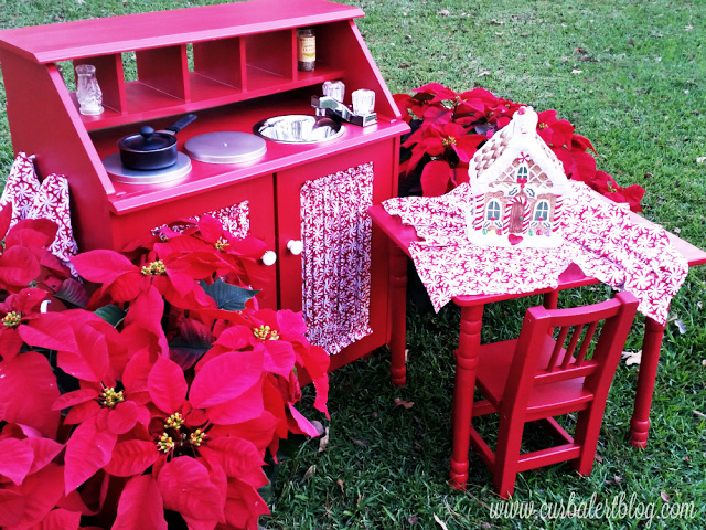 Candy Christmas Play Kitchen on the grass outside.