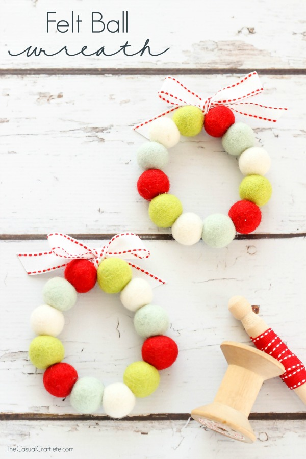 Felt Ball Wreath in red, white, and light blue with a red and white bow.