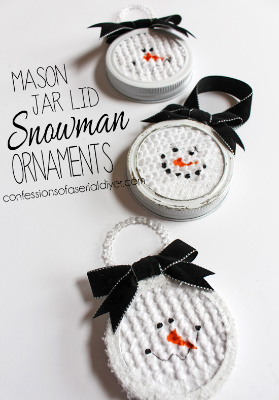 Snowman Ornaments made from Mason Jar Lids with black bows.