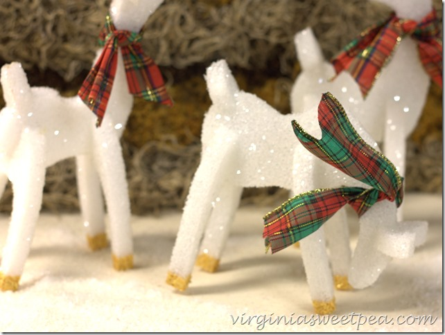 White Sparkly Christmas Reindeer With Plaid Bows.