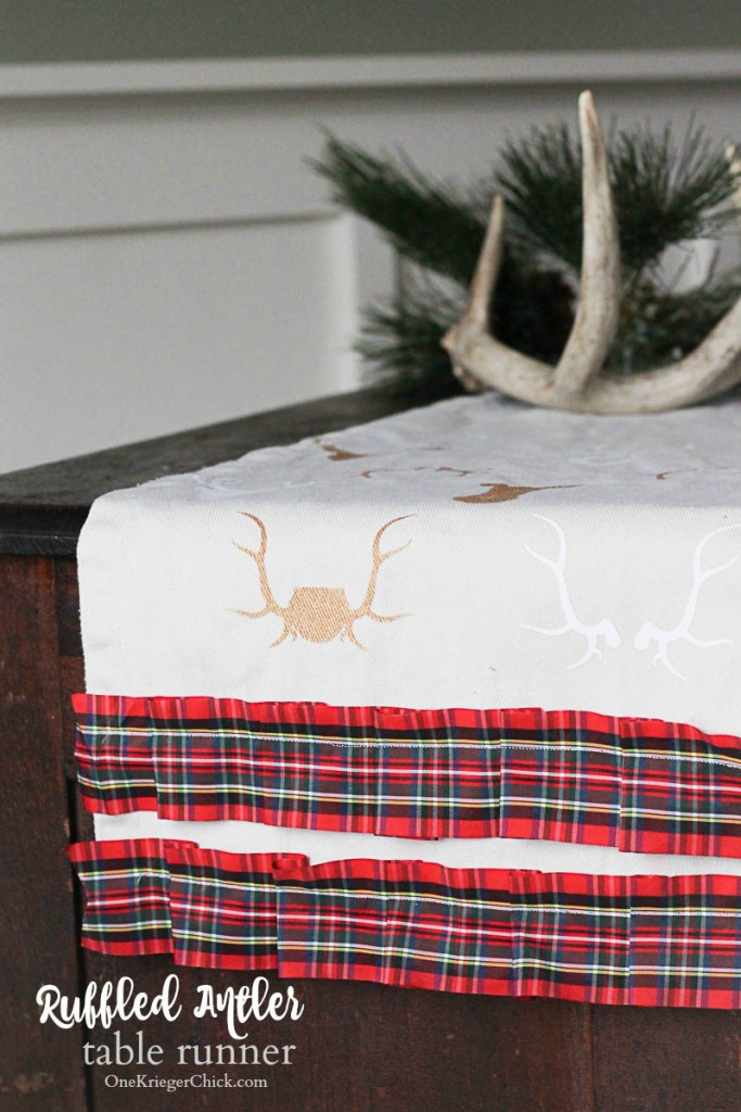 Ruffled Plaid & Antler Table Runner on the table with antlers on it.