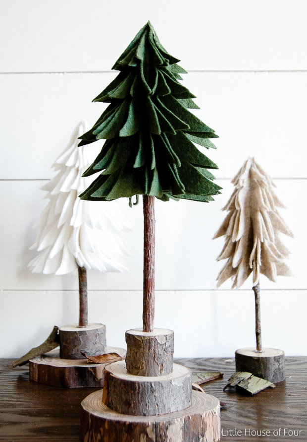 DIY Rustic Felt Christmas Trees on wood cut into circles as a base.