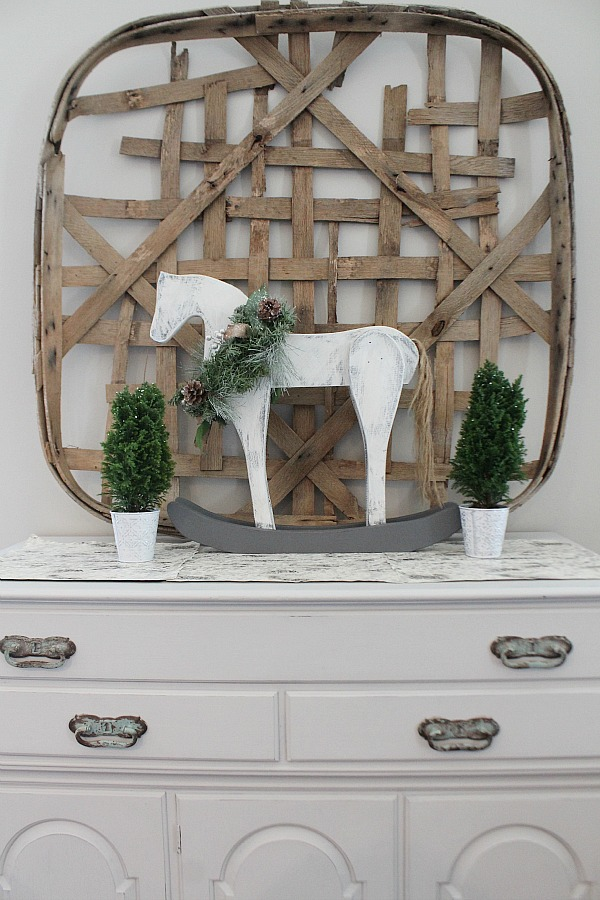 Vintage Wood Rocking Horse mini in white wash with a wreath around it on the dresser.