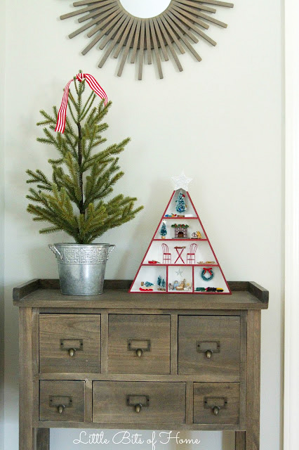 Miniature Christmas Display in a triangle on the desk.