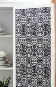 Cover the inside of a door with fabric to add a fun unexpected touch.