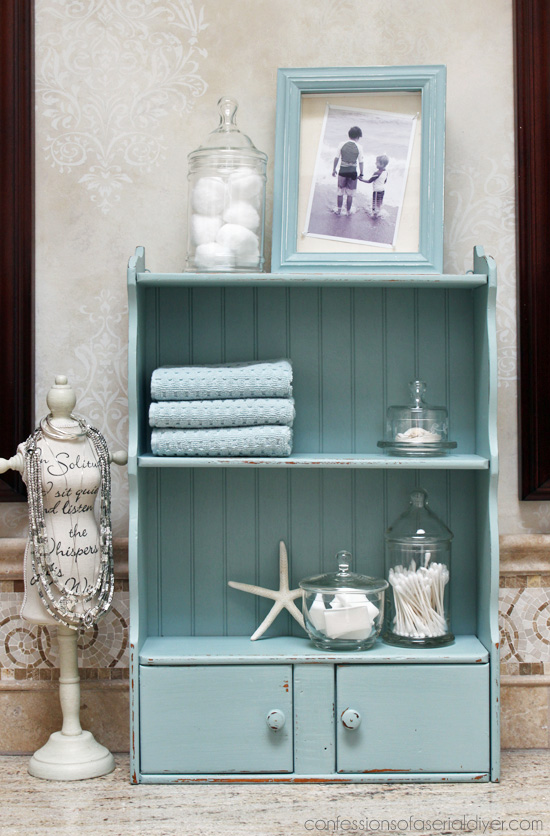 Turn a frumpy dated cabinet into a coastal cutie with a little beadboard and pretty blue paint.