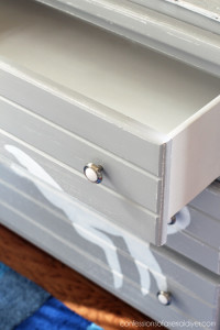 Spray paint is the best way to paint the insides of drawers.