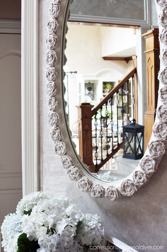 Thrift store mirror made over using dropcloth rosettes from Confessions of a Serial Do-it-Yourselfer