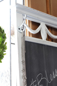 Adding hooks to this mirror turned chalkboard adds even more function.