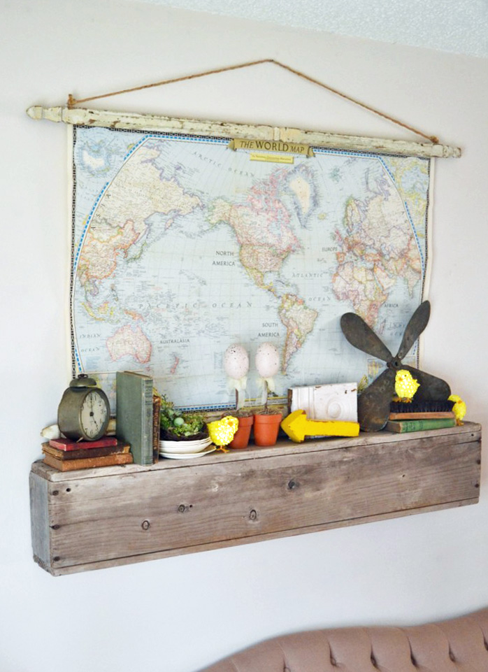 DIY Architectural Hanging Map above a wooden shelf.