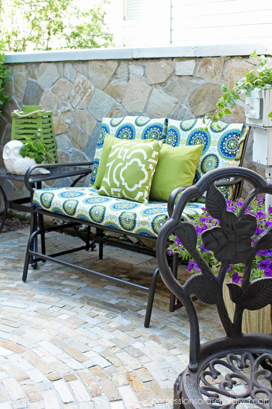 Outdoor Glider Bench Makeover with new cushion covers from Confessions of a Serial Do-it-Yourselfer