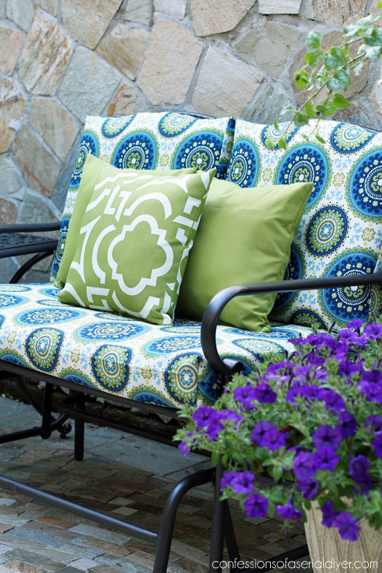 Nice Outdoor Glider Bench Makeover with new cushion covers from Confessions of a Serial Do it
