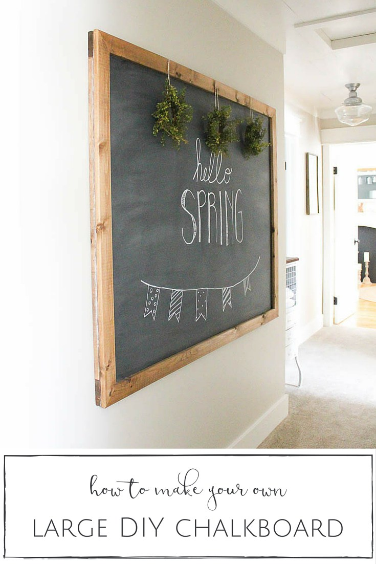 A large chalkboard with hello spring written on it.