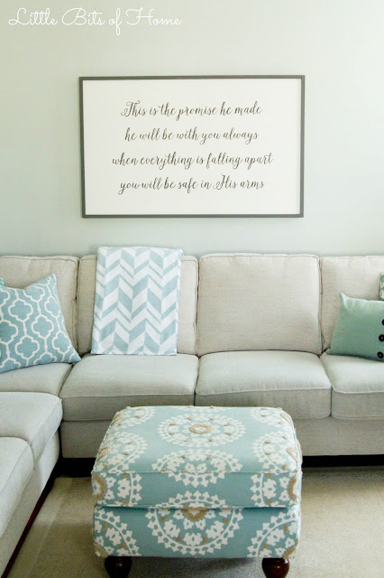 Lettered Wood Sign in the living room above the neutral couch and mint green walls.