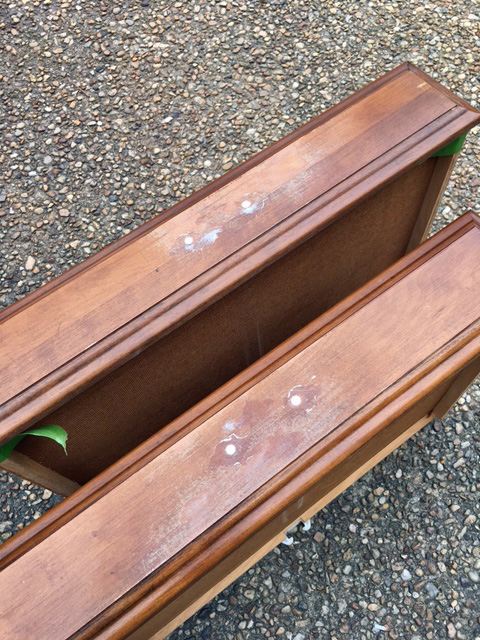 I filled in the holes on these bottom drawers using Elmers Wood Filler, so that I could attach prettier handles.