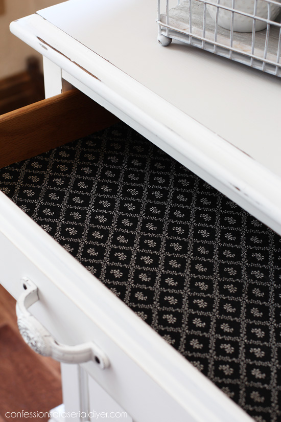 Adding fabric with Mod Podge gives the inside a fresh new feel.