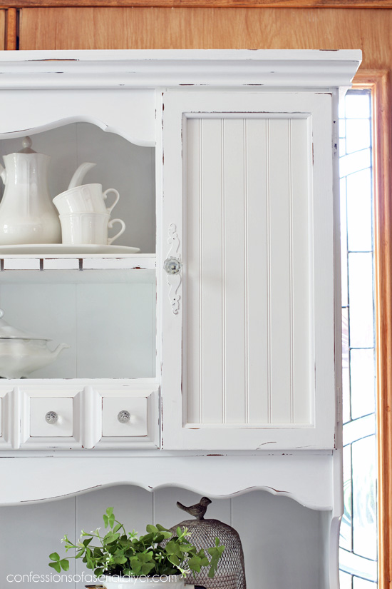 Replace outdated glass panels with beadboard.